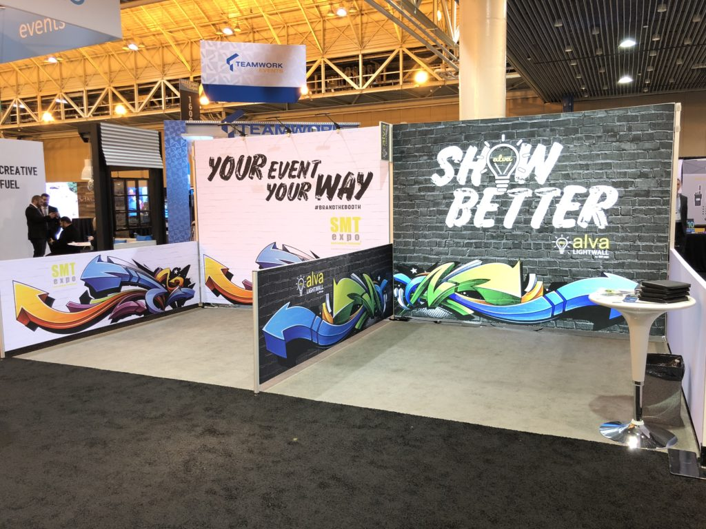 Two custom graphic low wall booths